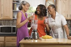 Women in kitchen with smoothies