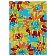 Hand-hooked indoor/outdoor rug with an oversized floral motif against a bright blue background.   Product: RugConstruction...