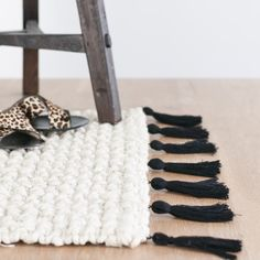 This tassel rug is the best of rustic minimal designer style for under $30