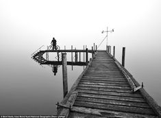 2012 National Geographic Photography Contest: During his 170km solo cycling trip around West Coast, New Zealand, Mohf Nadly Aizat Mohd Nudri came upon this foggy pier on Lake Brunner