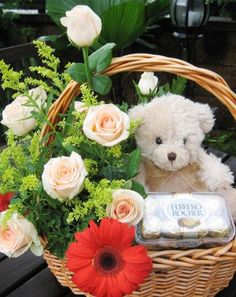 Online flower delivery in india. Roses, Chocolates and Teddy Bear together create a heart-warming Gift Hamper. Therefore, we create this Hamper for your special ones. It has a bunch of 10 Red Roses,2 Red Gerbera, a Teddy bear (6 Inch) and 16 Pcs Rocher Ferrero Chocolates arranged in basket.