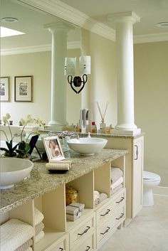 Vessel Sinks On Top Of Granite Counters, Cabinet Design Provides Open  Storage And Hides Plumbing Below.