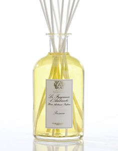 Antica Farmacista Diffuser Fragrance, the signature product in the collection, is a unique and beautiful way to fragrance and decorate the home. The Home Ambiance Fragrances utilize antique inspired apothecary bottles, filled with fragrance, to permeate the air through the bottles' open neck and white birch reeds that are inserted to further diffuse the scent. Simply position the fragrance bottle in the room of your choice and uncork. Place the reed bundle into the neck and reverse the re...