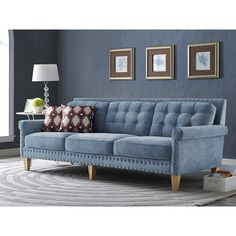 Jonathan Blue Velvet Sofa - TOV-S75Description :The neat, clean structure of the Jonathan sofa is a welcome addition to any room. Its versatile light blue velvet is as comfy as it is gorgeous. Featuring a solid wood frame with weathered Oak legs, the hand-applied nail heads and tufting complete the look. The Jonathan Sofa will complement any decor.Product Color :BlueLeg Color :Weathered OakDimensions :Sofa :90.5