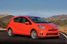 2012 Toyota Prius C  just bought this car and love the 53 mpg mileage!!  it's cute as a button.  yes it is orange!  Habenero chile pepper orange!
