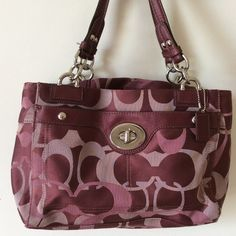 Burgundy/pink Coach Penelope shoulder bag Gorgeous burgundy signature Coach Penelope bag.   In excellent condition insid and out.  Zippered pocket and large pouch on outside.  Three compartments inside, one zippered.  Tiny bit of wear on handles. Coach Bags Shoulder Bags