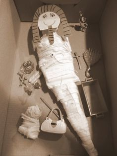 Barbie is ready to be welcomed into the afterlife accompanied by her favorite things and her beloved cat (also mummified)…..