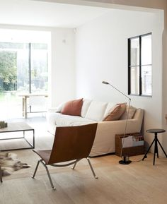 Vincent Holvoet, Belgium architecture, interios, living room, white sofa, leather chair