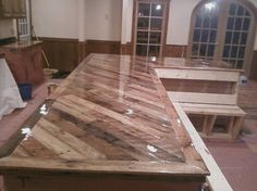 Kitchen counters out of pallets - no instructions - idea only. Obviously choosing non-chemically coated wood, and then making sure your sealant is food safe, and are imporant steps.
