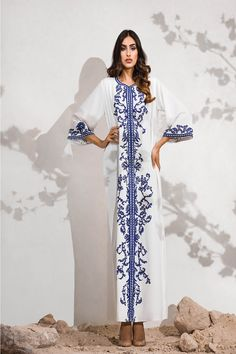 white crepe caftan with blue embroidery