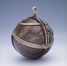 Spherical Astrolabe, Museum of the History of Science, 1480 - 1481. This astrolabe is made of brass with the inscriptions, hour-lines, meridians and circles of altitude in silver; the rotating star map is made of brass, laminated with silver on the ecliptic and equatorial circles