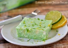 This delicious Lemon Lime Jello Salad is made with cottage cheese and pineapple - sooo good!   MomOnTimeout.com