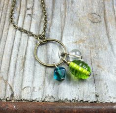 Celebration Necklace - chain, antique brass / gold, turquoise teal lime green white, hoop, charm pendant
