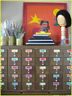 Card catalog turned into blissful craft storage. Great for little bits and pieces!  To say I love this idea is a huge understatement!!!