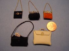 Miniature Purses.  Think of all the fun I can have with my girls designing purses.... :)