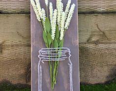 Items similar to Custom mason jar string art with faux flowers, mason jar string art, mason jar, ball jar, string art, flower arrangement, flowers, original on Etsy