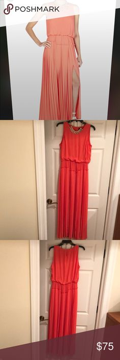 BCBG maxi dress Coral chiffon maxi dress. Loose flowy top. Elastic waistband. Pleated skirt has 2 high slits on each side. Slips on over the head with button at the top. Near perfect condition. Necklace not included BCBGMaxAzria Dresses Maxi