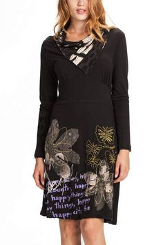 You'll love this knitted dress on cold days this fall-winter. It's long sleeved with a covered neck, making it look like you're wearing a foulard. Check out the embroidered detail of the butterflies. Do you like it