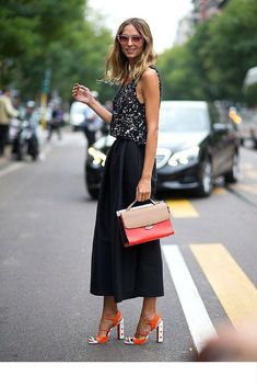 sneakers and pearls, street style, black cullotes, red highlights in any outfit will brighten up your day, trending now.jpg