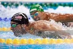 Michael Phelps (L) of the United States leads Chad le Clos of South Africa in…