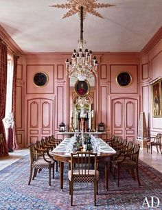 The pink paneled, Louis XV style dining room in Timothy Corrigan's own ridiculous chateau in France.