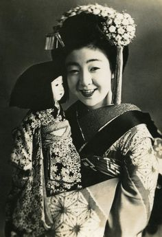 Maiko with a doll. 1930s. Exploited child. A poor girl sold and forced to work for years in the sex and entertainment business for the benefit of men with money. The pre-war Japanese government entirely failed Japan's female citizens.