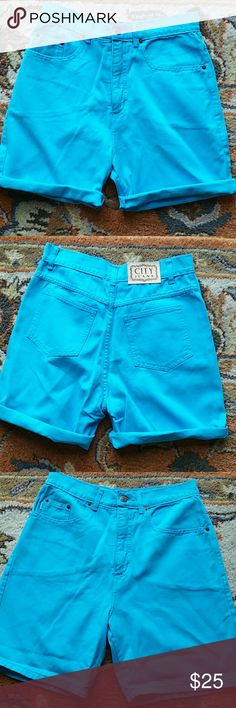 Turquoise highwaist shorts tag 8 or 28in 90s mom shorts. Color is a bright blue turquoise color. Tag is an 8 waist is a little over 14 inches. Soft fabric cotton. Inseam 6 inches.  Normal 90s wear no stains or rips Vintage Shorts