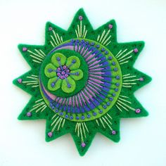 STARBURST FELT BROOCH WITH FREEFORM EMBROIDERY by APPLIQUE-designedbyjane, via Flickr