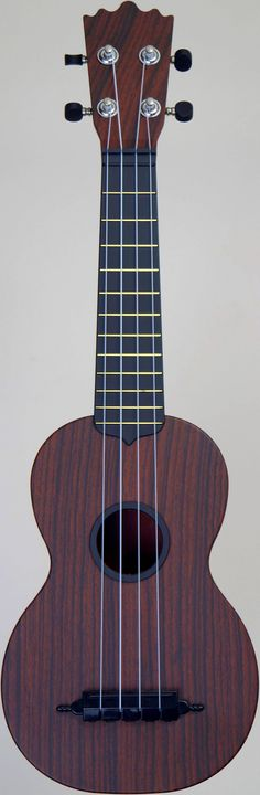 "[Uke of the day 2014] My faux wood ""Woodi"" Soprano at Ukulele Corner --- https://www.pinterest.com/lardyfatboy/"