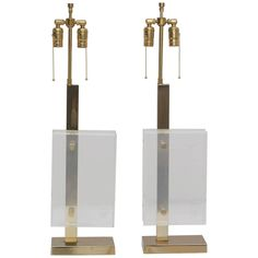 Pair of Brass and Lucite Pierre Cardin Table Lamps | From a unique collection of antique and modern table lamps at https://www.1stdibs.com/furniture/lighting/table-lamps/