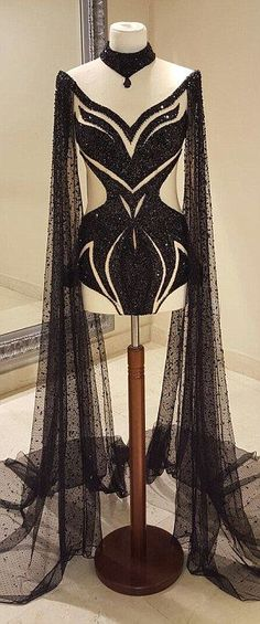 Whimsical: There is also Britney's new black cutout body-con look with a sheer floor-length cape from LaBourjoisie