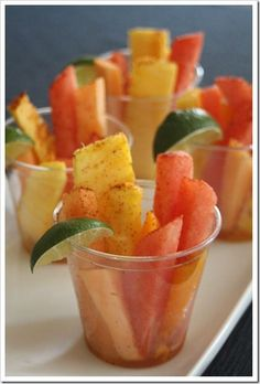 Mexican Fruit Cups - fresh fruit tossed in lime juice and sprinkled with a little chili powder. So yummy and perfect for a Cinco de Mayo gathering!