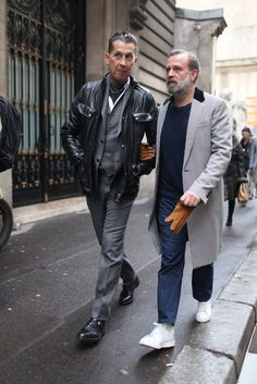 Dress in a black leather field jacket and charcoal trousers for a casual level of dress. Polish off the ensemble with black leather double monks.   Shop this look on Lookastic: https://lookastic.com/men/looks/field-jacket-blazer-waistcoat-long-sleeve-shirt-dress-pants-double-monks-scarf/5792   — Charcoal Scarf  — White Long Sleeve Shirt  — Charcoal Waistcoat  — Charcoal Blazer  — Black Leather Field Jacket  — Charcoal Dress Pants  — Black Leather Double Monks
