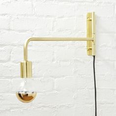 Shop swing arm brass wall sconce.   All aglow in brushed brass, this steel construction by Lime Studio works all the light angles with a simple swivel, casting light right where you need it.