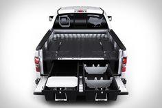 Maximize your truck's practicality by keeping all your belongings stashed away within this truck bed organizer. Once installed, you'll have two bed-length drawers and four ammo cans at your disposal so that all your gear remains neatly arranged. New Trucks, Pickup Trucks, Decked Truck Bed, Truck Bed Storage, Vehicle Storage, Truck Bed Accessories, Navara D40, Ammo Cans, Autos