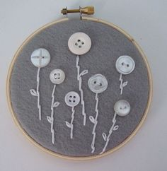 I made one like this with flower-shaped mother of pearl buttons and five flowers -- one for each member of our family (not counting our kitty). :-)