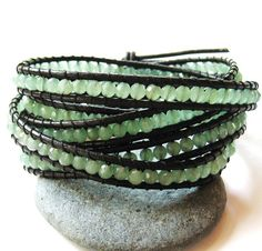 etsy: Cool sea green faceted adventurine rounds dance along two strands of leather, wrapping around the wrist five times. An Italian crafted button creates the toggle clasp. SO EASY TO DIY!!!