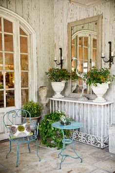 Entrance to our showroom filled with antique garden and patio furniture and accessories.