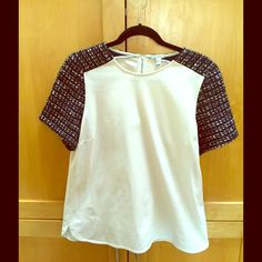 Classic coco tweed design top. This tweed design top adds class to any outfit. Black and white and shimmer tweed on sleeves and shoulders with cream color body.   ✔️ Please submit your best offer using the blue offer button.  ✔️ Bundle 3+ items, get 20% off  No Trades, PayPal, or Negotiating in the comments. J. Crew Tops