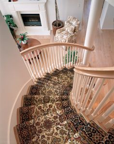 Beautiful curved stairway runner. Available from http://shenandoahvalleyrugcompany.com