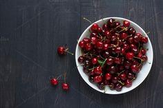 Bowl full of fresh cherries. by kawizen  on Creative Market