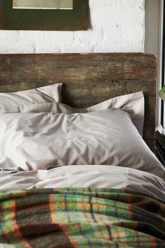 rustic headboard and tartan blanket....coziness!