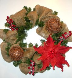Burlap Christmas door wreath with poinsettia, pine cones, berries, rustic, natural. via Etsy.