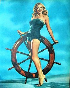 Helmsman...Rita Hayworth; taking her work home with her... Ahoy there, wheres the ship??