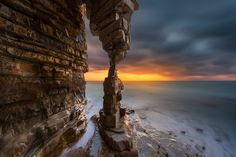 The table legs in the sunset - In dalian wafangdian region of China, off the coast of camel mountain landscape, rows of stacking rocks. Photography by shanyewuyu