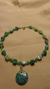 Green Millefiori Ankle Bracelet  Fun & cute ankle bracelet made of glass millefiori square beads accented with green swarovski crystals and silver, and ends with a silver lobster claw clasp. Has a round glass millefioripendant that dangles.  Meas...