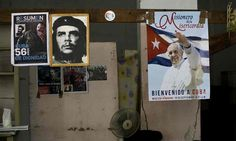 A poster of Pope Francis hangs next to a picture of revolutionary hero Ernesto Che Guevara, center, and Fidel Castro inside a government-run store that sells flour and beans in Havana, Cuba, on Friday/