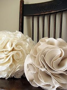 Fabric pom poms. A fancier version of the tissue paper pom poms...I kind of want them all over my apartment.