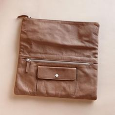 fold over clutch with hidden zip and coin pocket