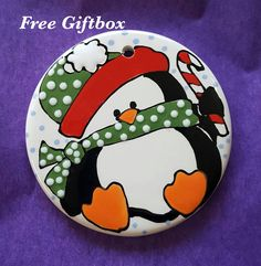 Christmas Ornament, Penguin Ornament, Baby's Christmas, Penguin Lover, Ornament for Child. By Brush Stroke Plates Penguin Ornaments, Painted Christmas Ornaments, Baby Ornaments, Hand Painted Ornaments, Babys 1st Christmas, Christmas Rock, Christmas Crafts, Pottery Painting Designs, Rock Painting Designs